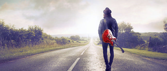 Guitar Player Walking